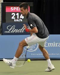 Học tennis nâng cao-Đánh bóng qua hai chân